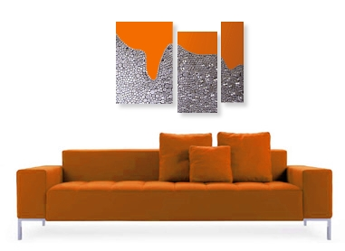An orange, platinum and rust wall sculpture with some amber and grey